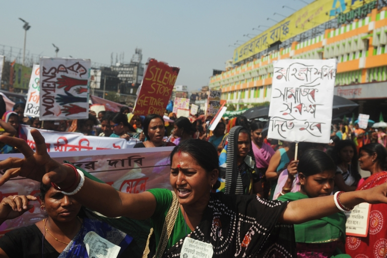 <p>Indian female laborers and sex workers participate in a rally on International World Women's day in Kolkata on March 8, 2013. Elsewhere, in the state of Odisha, women stripped in protest of a land acquisition deal.</p>