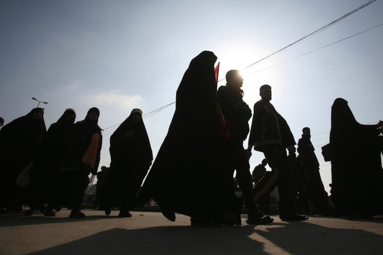 <p>Shiite Muslim pilgrims arrive on Jan. 19, 2011, in the central Iraqi shrine city of Karbala, 120 kms south of the capital Baghdad, to take part in the upcoming Arbaeen religious festival which marks the 40th day after Ashura. Ashura commemorates the killing of the Prophet Mohammed's grandson the Imam Hussein in the seventh century (680AD) by armies of the caliph Yazid in the battle of Karbala.</p>