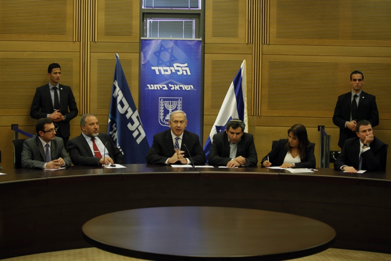 <p>Israeli Prime Minister Benjamin Netanyahu chairs the Likud-Beiteinu faction meeting at the Knesset (Israel's Parliament) on March 14, 2013 in Jerusalem. Netanyahu is to formally unveil the shape of his long-awaited coalition government which will be sworn in just days before a visit by US President Barack Obama.</p>