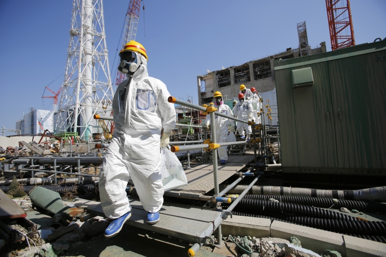 <p>Visitors and workers are required to wear protective suits and masks at Japan's Fukushima nuclear power plant, which was rocked by the March 11, 2011 tsunami and earthquake. Employees are currently checking the plant's storage tanks for leaks, after radioactive water was found to be seeping into the ground on August 19, 2013.</p>