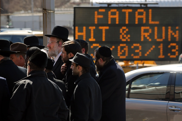 <p>Members of the Brooklyn Orthodox community attend a news conference to discuss the recent deaths of a Orthodox couple and their unborn child, killed in a hit and run crash in Brooklyn on March 4, 2013 in New York City.</p>