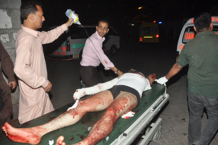 <p>Relatives transport an injured bomb blast victim in Karachi, Pakistan, on March 3, 2013. A bomb attack in Karachi, Pakistan's largest city, on March 3 killed at least 45 people and wounded 150 others, officials said.</p>