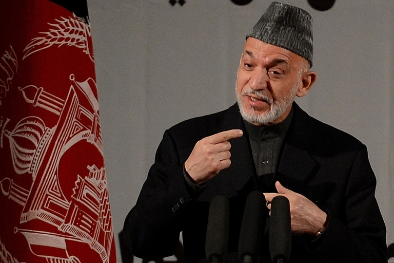 <p>Afghan President Hamid Karzai speaks at a gathering of women to mark International Women's Day, in Kabul on March 10, 2013. Karzai's recent comments about US-Taliban relations have certainly raised some eyebrows, but it's clear as the US combat mission enters its final stages that the situation is far from rosy.</p>