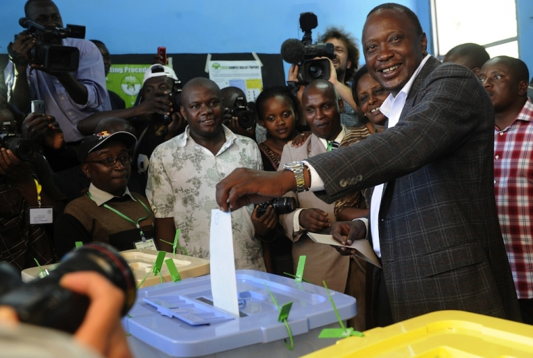 <p>Kenya's Deputy Prime Minister and presidential candidate Uhuru Kenyatta casts his vote at the Mutomo primary school in Kiambu on March 4, 2013.</p>