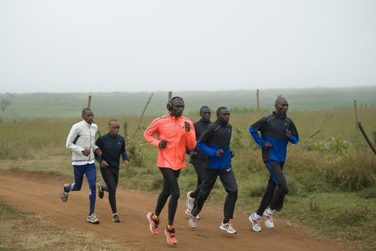 <p>David Rudisha (in orange), the 800-meter world record holder, runs during a morning workout near Nairobi, Kenya, on July 25, 2012.</p>