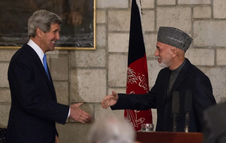 <p>US Secretary of State John Kerry and Afghanistan's President Hamid Karzai shake hands at the end of their press conference at the Presidential Palace in Kabul, on March 25, 2013.</p>