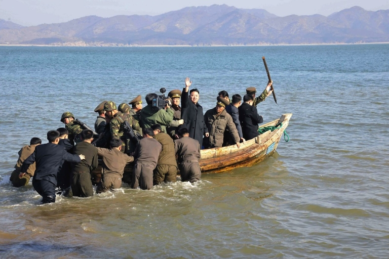 <p>This undated picture taken by North Korea's official Korean Central News Agency on March 11, 2013 shows North Korean leader Kim Jong Un (C) leaving the Wolnae Islet Defence Detachment after inspection in North Korea's western sector near the disputed maritime frontier with South Korea.</p>