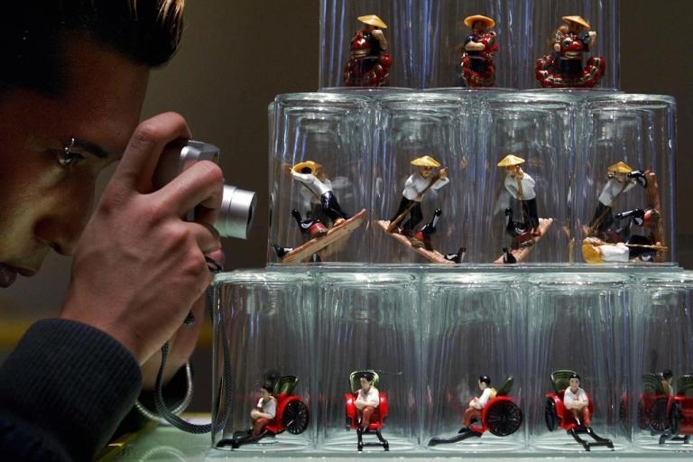 <p>A German man photographs an exhibit at the