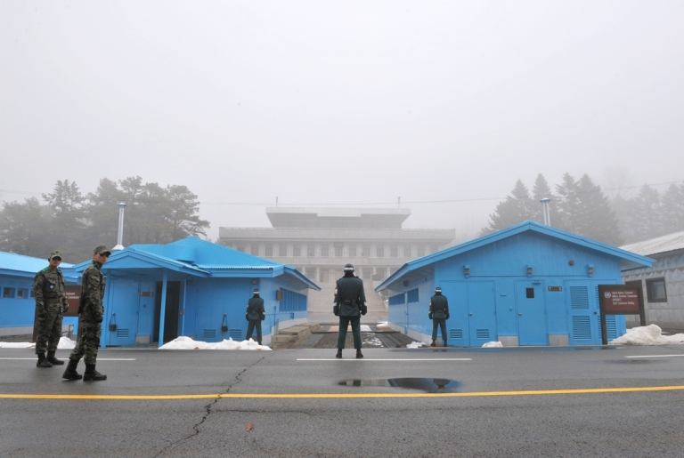 <p>South Korean soldiers stand guard in fog at the truce village of Panmunjom in the demilitarized zone dividing North and South Korea on February 27, 2013. North Korea has threatened to cancel the truce between the two countries that ended their 1950-53 war.</p>