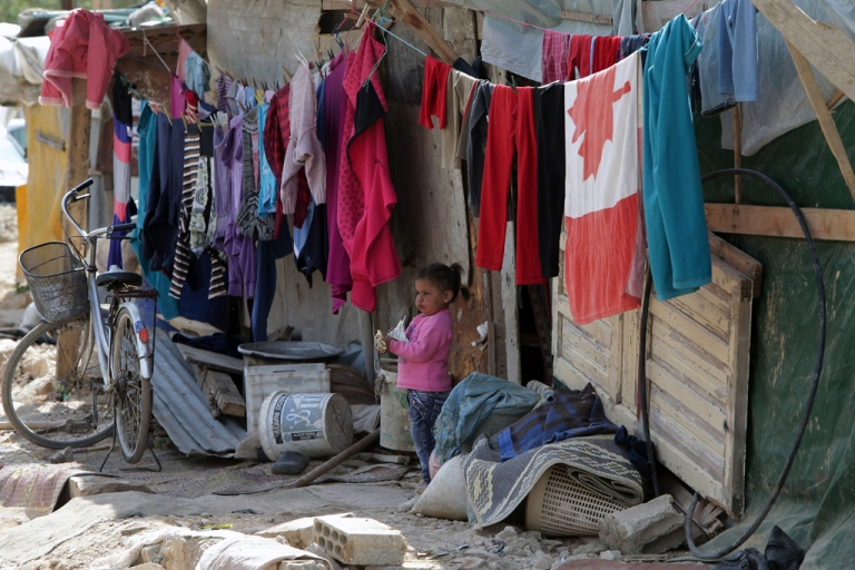 <p>A Syrian refugee child stands outside the shanty rented by her parents in a poor neighborhood of the northern Lebanese city of Tripoli on March 7, 2013. A significant number of Syrians have fled their country since deadly civil strife erupted just over two years ago, but now the focus has turned to financial aid as some of the refugee programs struggle to deal with the growing number of those displaced by the conflict.</p>