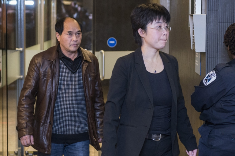 <p>Jun Lin's father, Diran Lin, leaves the courthouse with an interpreter on Monday where Luka Rocco Magnotta appeared for a preliminary hearing March 11, 2013 in Montreal, Canada.</p>