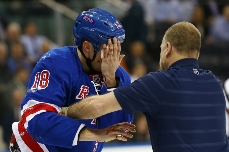 <p>Marc Staal of the New York Rangers leaves the ice after he was hit in the face with a puck in the third period against the Philadelphia Flyers on March 5, 2013 at Madison Square Garden in New York City.The New York Rangers defeated the Philadelphia Flyers 4-2.</p>