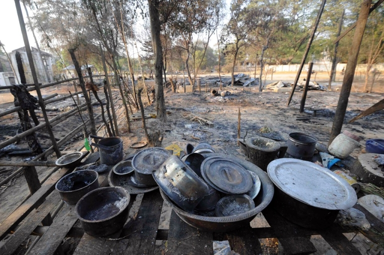 <p>Burnt kitchenware sits on a shelf at house which was burnt in communal violence in Yamethin, near the capital Naypyidaw, after unrest spread in central Myanmar on March 24, 2013.</p>