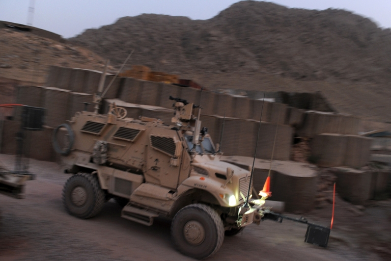 <p>A US armored vehicle moves out from Forward Base Walton for a convoy patrol in Arghandab district, a former Taliban stronghold in southern Afghanistan, on July 28, 2011. A NATO helicopter mistakenly killed two boys, ages 7 and 8, during a search for insurgents on Feb. 28, 2013 in the southern province of Uruzgan.</p>