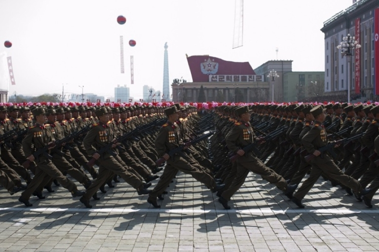 <p>North Korean soldiers march during a military parade to mark 100 years since the birth of North Korea's founder Kim Il-Sung in Pyongyang on April 15, 2012.</p>