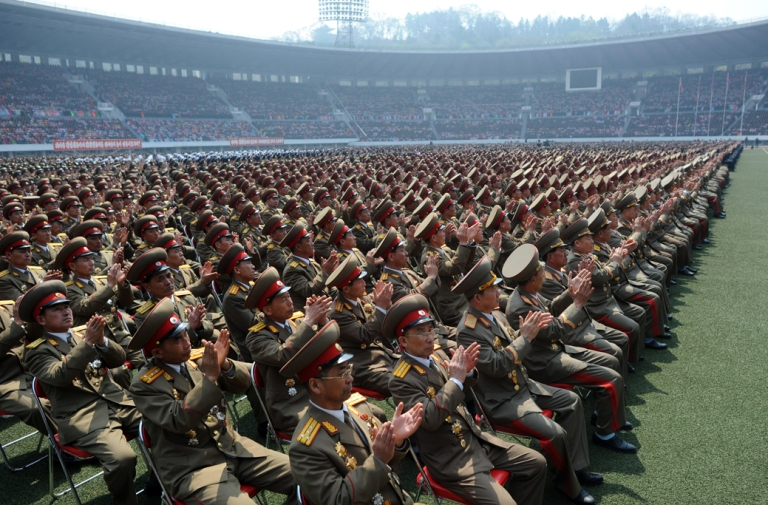 <p>North Korean soldiers applaud as they listen to a speech during an official ceremony attended by leader Kim Jong-Un at a stadium in Pyongyang on April 14, 2012. Negotiations with North Korea in recent history have focused increasingly on security issues, in lieu of human rights abuses that continue to affect people throughout Kim Jong-Un's hermit kingdom.</p>