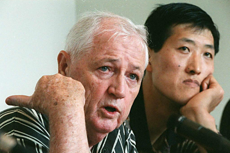 <p>Jack Donohue, former Canadian basketball team coach, and North Korean basketball player Ri Myong-hun speak to reporters on June 10, 1997, during a news conference in Ottawa, Canada. Ri, who is 7-feet-8, was trying to make the NBA.</p>