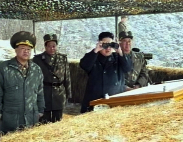<p>This screengrab taken from North Korean TV shows North Korean leader Kim Jong Un's overseeing a live fire military drill on March 20, 2013.</p>