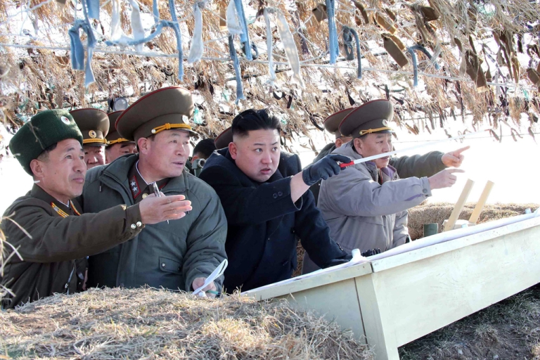 <p>This undated picture taken by North Korea's official Korean Central News Agency on March 11, 2013 shows North Korean leader Kim Jong Un (C) inspecting the Wolnae Islet Defense Detachment in North Korea's western sector near the disputed maritime frontier with South Korea.</p>