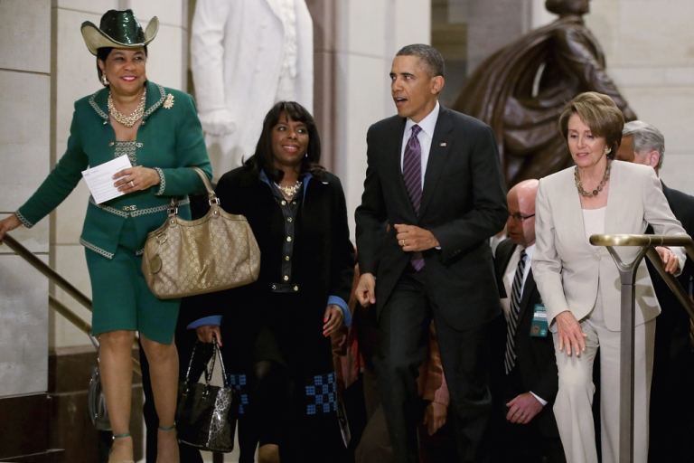 <p>US President Barack Obama leaves a House Democratic Caucus meeting with (L-R) US Rep. Frederica Wilson (D-Fla.), (L) US Rep. Terri Sewell (D-Ala.), and (2nd L) House Minority Leader Nancy Pelosi (D-Calif.) on March 14, 2013, in Washington, DC. During his third day of meetings with members of Congress, Obama met with Senate Republicans and House Democrats to discuss a number of issues facing the US budget situation.</p>