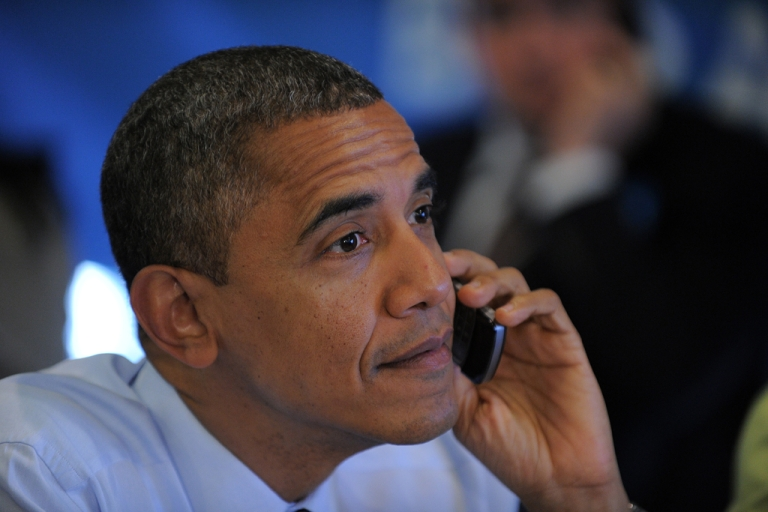 <p>United States President Barack Obama calls volunteers from a campaign office in Chicago, Ill., on election day, Nov. 6, 2012.</p>
