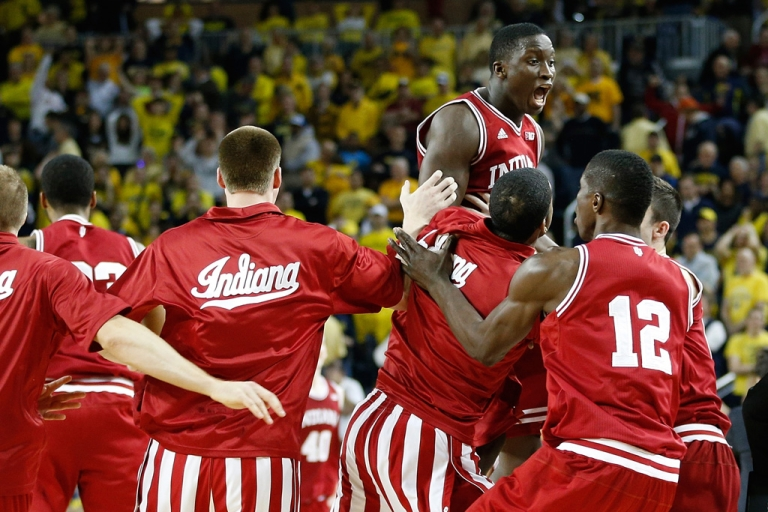 <p>Victor Oladipo (No. 4) of the Indiana Hoosiers celebrates a 72-71 victory over Michigan Wolverines with teammates at Crisler Center on March 10, 2013 in Ann Arbor, Michigan.</p>