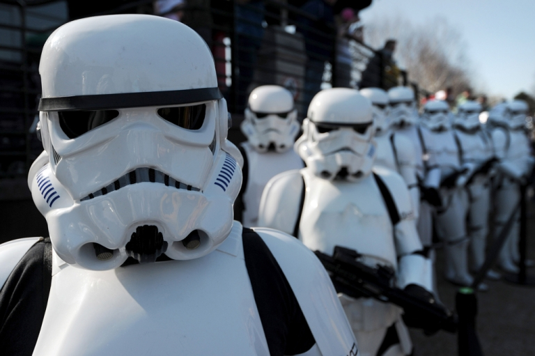 <p>Star Wars Stormtroopers pose for photographers in a queue at Legoland in Windsor west of London on March 24, 2012, to mark the launch of the new Star Wars Miniland Experience.</p>