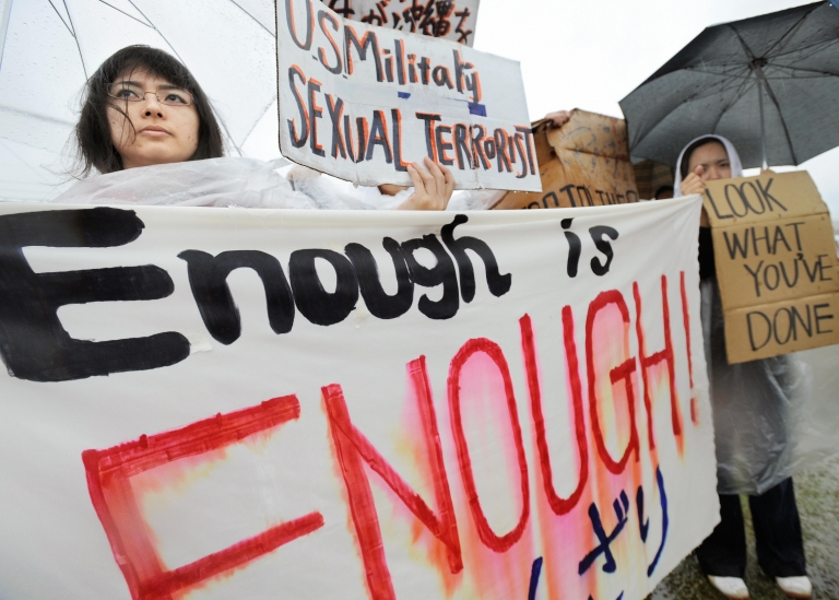 <p>Young Japanese women hold banners during a major rally against the US military at a park in Okinawa after a string of serious misconduct by its soldiers including alleged rapes in the Japan's southern island province on March 23, 2008. More than 6,000 people took part in the rally on the island, home of more than 40,000 US troops stations in Japan.</p>