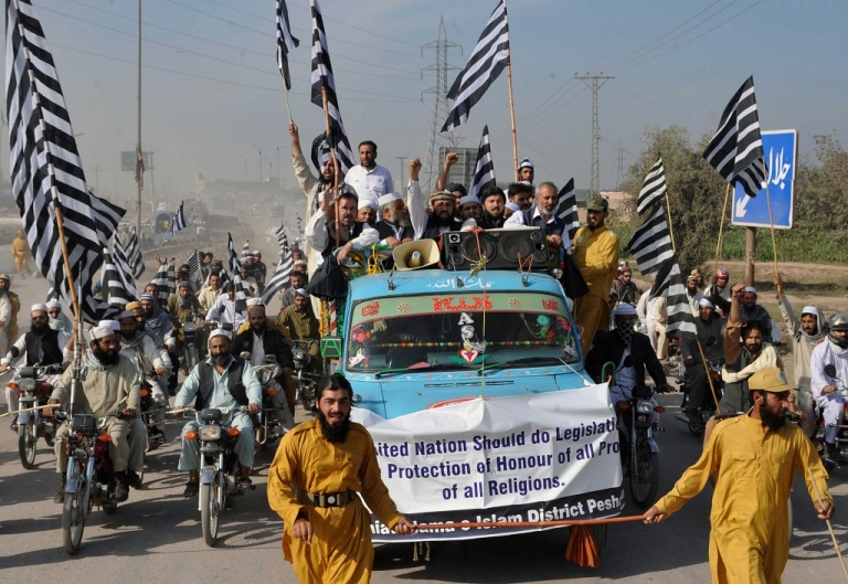 <p>Activists of Jamiat ulema-e-islam (JUI) Pakistan participate in a rally in Peshawar on November 15, 2012. The demonstrators demanded the United Nations prepare legislation for protecting the honour of all prophets of all religions, following backlash against the 'Innocence of Muslims,' an amateurish film depicting the Prophet Mohammed as a thuggish deviant which triggered a wave of violent protests that left dozens dead in September.</p>