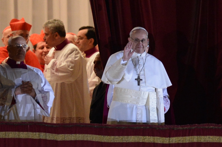 <p>Argentina's cardinal Jorge Bergoglio, elected Pope Francis I (R) addresses the crowd on the balcony of St Peter's Basilica's after being elected the 266th pope of the Roman Catholic Church on March 13, 2013 at the Vatican.</p>