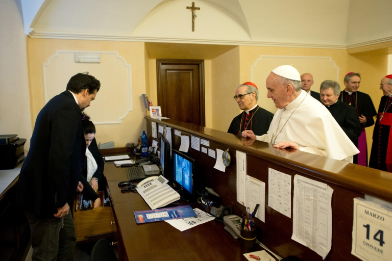 <p>This handout picture released by the Vatican press office shows Pope Francis at the reception desk of the Domus Internationalis Paulus VI residence as he pays his bill on March 14, 2013 in Rome.</p>