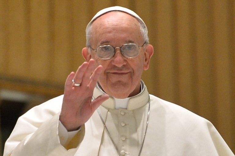 <p>Pope Francis arrives for a private audience to members of the media on March 16, 2013 at the Paul VI hall at the Vatican. Pope Francis called for