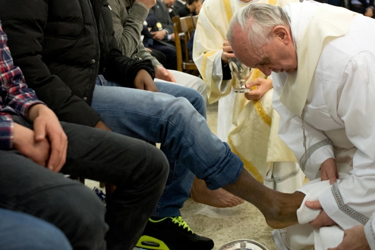 <p>Pope Francis washes the feet of a prisoner at the Casal Del Marmo Youth Detention Centre during the mass of the Lord's Supper on March 28, 2013 in Rome, Italy.</p>