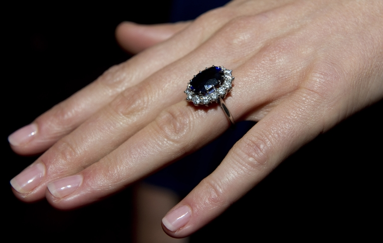 <p>A close-up of Kate Middleton's engagement ring, a blue sapphire and diamond ring that originally belonged to Diana, Princess of Wales.</p>