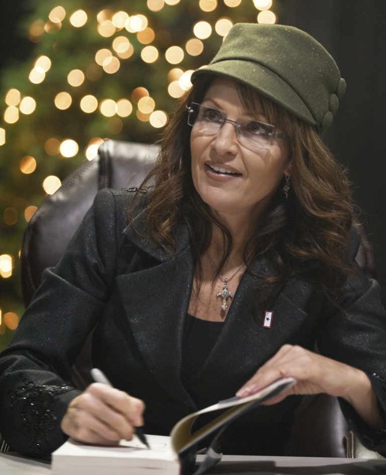 <p>Former Alaska Governor and Republican vice presidential candidate Sarah Palin arrives to sign copies of her recently released book 'Going Rogue: An American Life', sitting in front of a Christmas Tree on December 5, 2009. She is penning her third book about