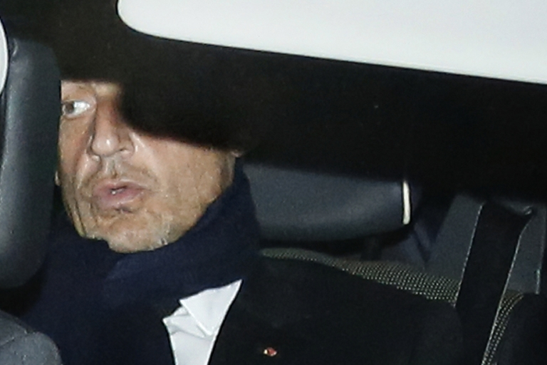 <p>Sarkozy leaves a Bordeaux courthouse on Thursday after a hearing over claims he accepted envelopes stuffed with cash from L'Oreal heiress Liliane Bettencourt.</p>