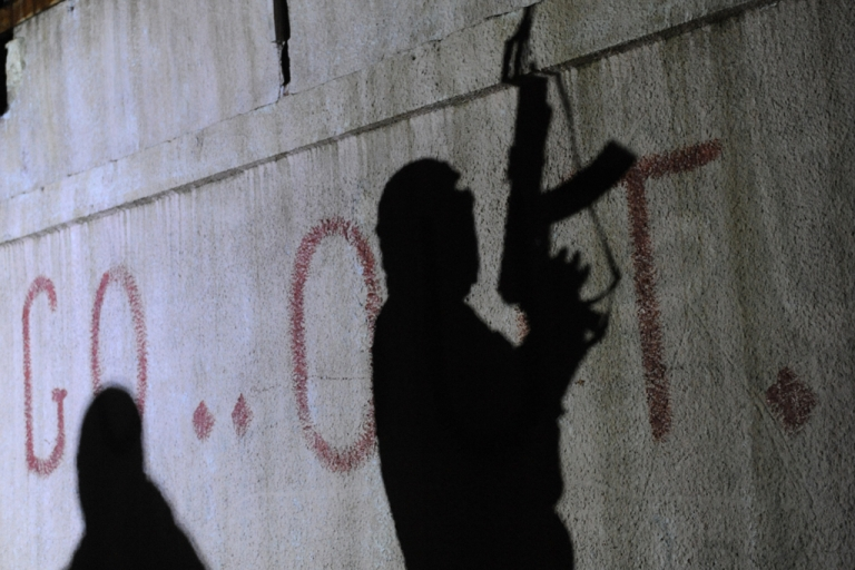 <p>The shadows of armed Free Syrian Army rebels are seen on a wall at the entrance to the north Syrian city of Binnish on Feb. 15, 2012.</p>