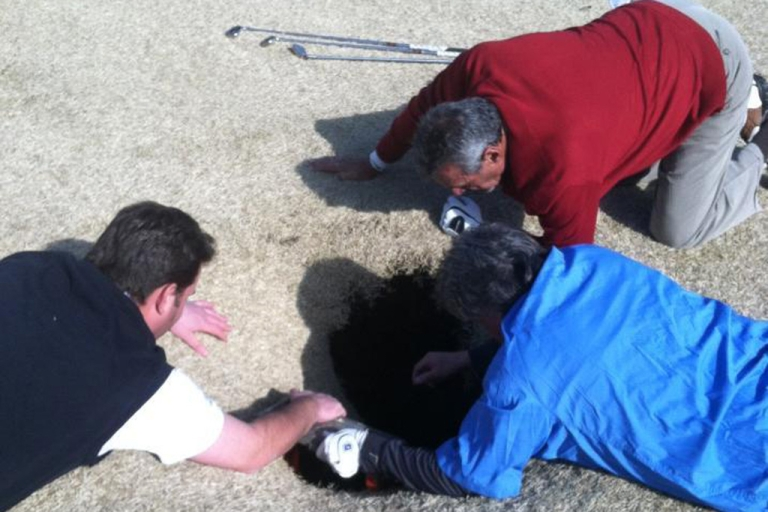 <p>Mark Mihal's golfing buddies and course staff work to free him after an 18-foot sinkhole opened up and swallowed him on March 8, 2013, at Annbriar Golf Course in Waterloo, Ill.</p>