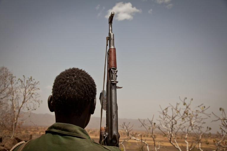 <p>A Sudan People's Liberation Movement rebel soldier looks out toward Talodi in of Sudan, on April 25, 2012.</p>