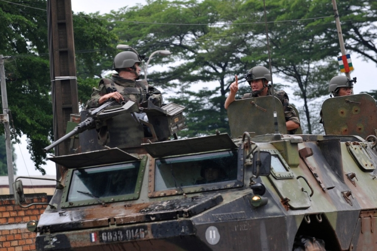 <p>French soldiers patrol in a military truck in a street of Bangui, Central African Republic on March 25, 2013.</p>