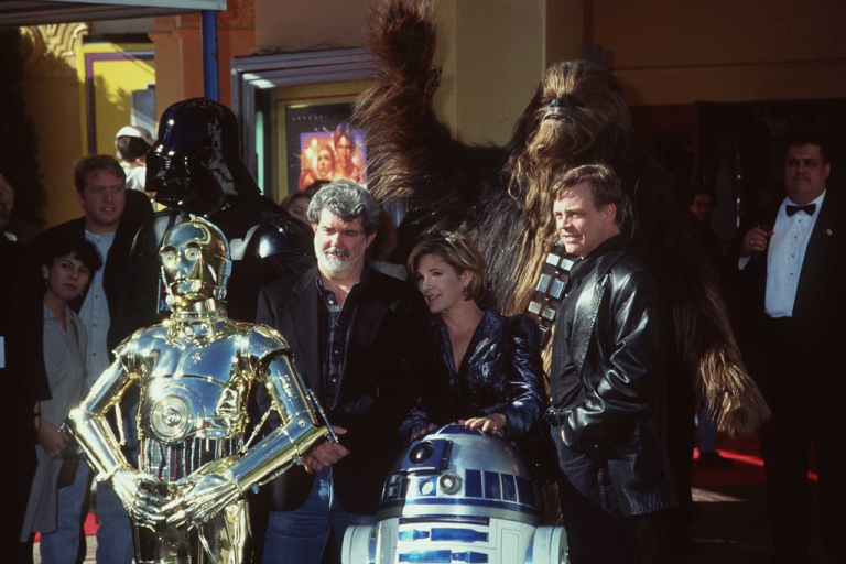 <p>George Lucas, Carrie Fisher, Mark Hamill and actors portraying C-3PO, R2-D2, Darth Vader and Chewbacca attend the premiere of the 1997 Star Wars Trilogy Special Edition to celebrate the 20th anniversary of the release of Star Wars Episode IV: A New Hope on Jan. 18, 1997.</p>