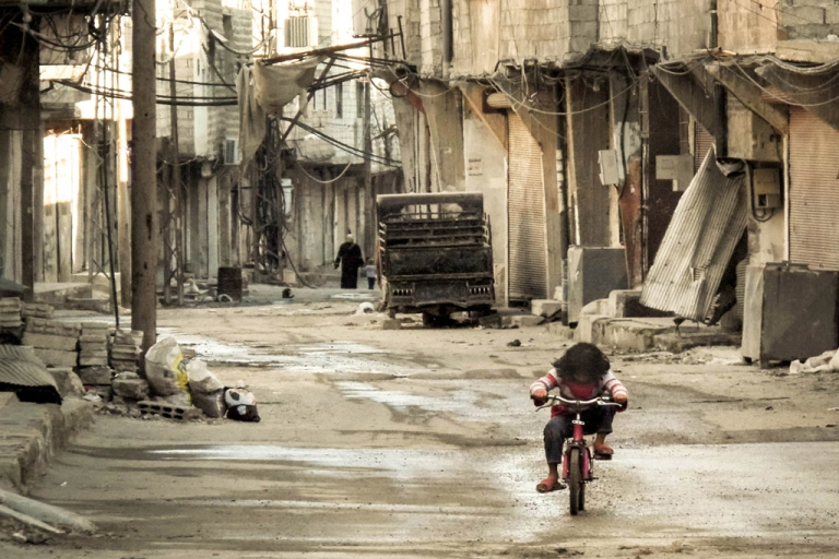 <p>A Syrian girl rides her bicycle in an almost deserted street in the Teshrin neighborhood of Damascus on Jan. 3, 2013. According to Israeli military intelligence, the Syrian government has repeatedly used chemical weapons against the rebels fighting to overthrow it.</p>