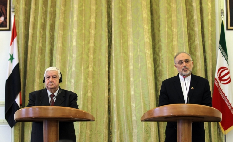 <p>Iranian Foreign Minister Ali Akbar Salehi (R) and his Syrian counterpart Walid Muallem during a press conference on March 2, 2013 in the Iranian capital Tehran. Syria and Iran have accused the US of hypocrisy for offering aid to Syrian rebels.</p>