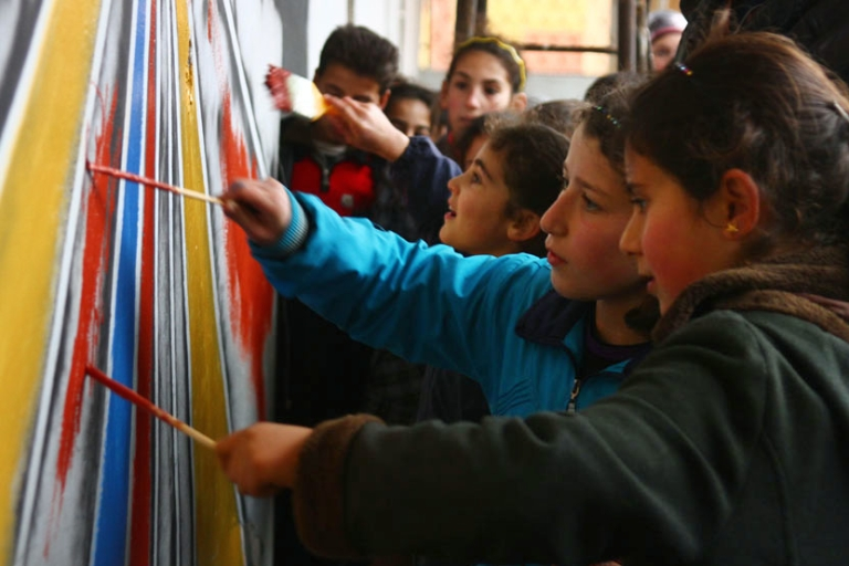 <p>Children at Fatima Harmadi's school in Idlib take part in an art therapy project last month.</p>