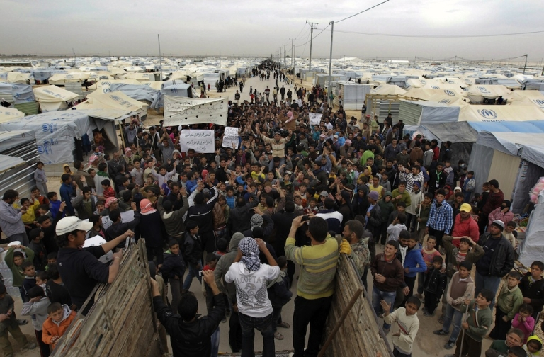 <p>Syrian refugees take part in a demonstration at the Zaatari refugee camp near the Syrian border on Feb. 22.</p>