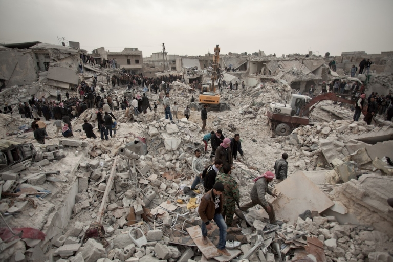 <p>Syrians search for survivors and bodies amid the rubble of buildings in the Tariq al-Bab district of the northern city of Aleppo on Feb. 23, 2013.</p>