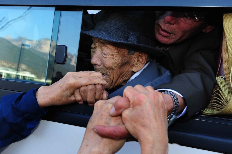 <p>North Koreans part with South Korean relatives after a family reunion in 2010.</p>