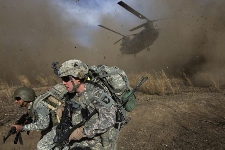 <p>In this photo taken on Nov. 11, 2009, US Army soldiers race to get out of the way of a CH-47 Chinook helicopter landing in the Khost province of Afghanistan.</p>