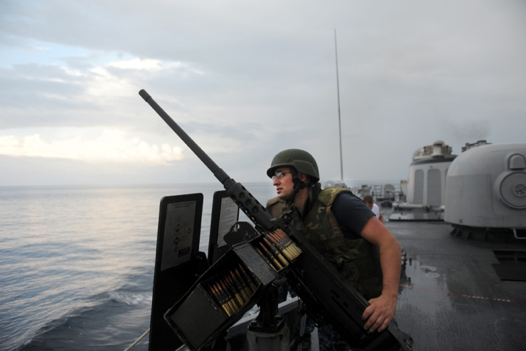 <p>Crew members of the USS Thach observe suspect Ecuadorean fishing boats on March 3, 2013, during a drug interdiction while patrolling international waters in the Pacific Ocean near Colombia and Ecuador. The USS Thach participates in the Martillo Operation, a US led multilateral operation launched in January 2012 to combat drug smuggling in Central America.</p>