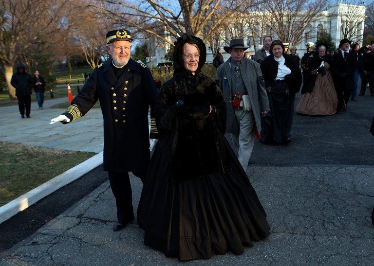 <p>Civil War enthusiasts depart following a funeral service at Arlington National Cemetery for two unknown sailors who were killed in 1862 when the USS Monitor sank off the coast of North Carolina.</p>